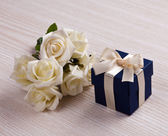 White flowers and blue gift box — Stock Photo