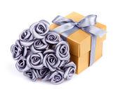 Gray flowers and yellow gift box — Stock Photo