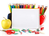 Notebook with school stationary objects — Stock Photo