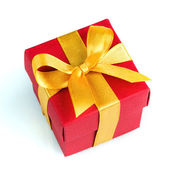 Single red gift box with golden ribbon — Stock Photo