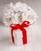 White flowers and gift box — Stock Photo