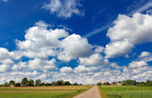 Landscape with road and clouds — Stock Photo