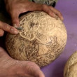 Stock Video: Carve coconut hindu symbol II