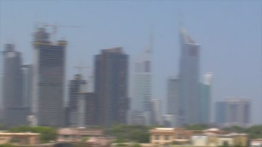 Zoom pan from emirate towers to burj dubai 10276 — Stock Video