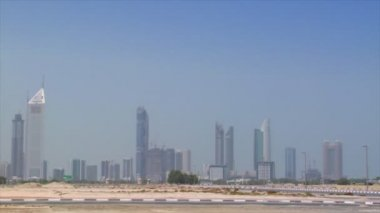 Limousine cross Dubai skyline pan burj emirates 10298 — Stock Video