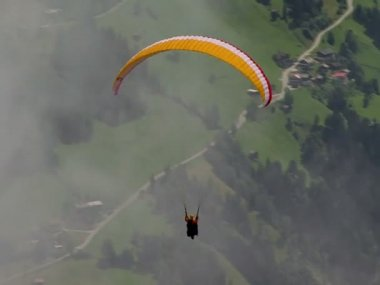 Parachute - paraglider out of clouds 10327 — Stock Video
