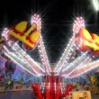 Stock Video: Funfair carousel jumping with dreamy look 11070