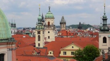 Pan over historic roofs and towers of prague 11375 — Stok video