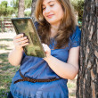 Girl with her tablet — Stock Photo