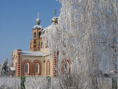 Russian Orthodox Church in the winter frosty sunny day — Stock Photo