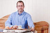 Man at breakfast table — Stock Photo