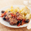 Pork provencal with baked potatoes — Stock Photo