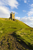 Dunstanburgh castle, northumberland — Stockfoto