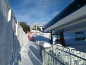 Chairlift on a ski resort on bright winter afternoon — ストック写真
