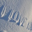 Writing text I LOVE YOU on the white snow surface — Stock Photo #18744929