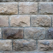 Old stone wall built of rectangular stone — Stock Photo