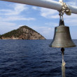 Boat bell and small island - Stock Photo