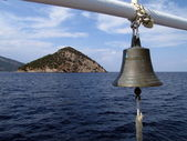 Boat bell and small island — Stock Photo