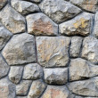 An irregular stone wall background — Stock Photo