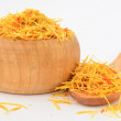 Saffron in wooden bowl — Stock Photo #37487015