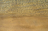 Golden sand and sea surface — Stock Photo