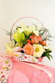 Gift and flower arrangement — Stock Photo