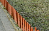 Small wood fence at garden — Stock Photo