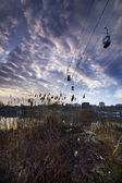 Cable cars under the field — Stock Photo