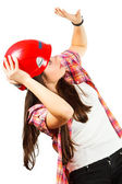 A girl in a red helmet with dread looks up — Stock Photo