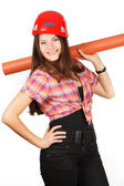 A girl in a helmet holds a paper roll on shoulders — Stock Photo