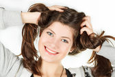 A portrait of girl is in a sportswear that twirled hair hands — Stock Photo