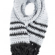 Grey scarf of handwork knitted by a hook on a white background — Stock Photo #48257873