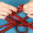 Handwork. weaving belt of satin ribbons — Stock Photo #49598055