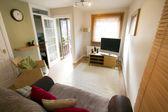 Open door in sitting room — Stock Photo