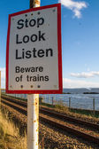 Stop beware of trains sign — Stock Photo