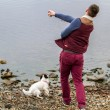 Mthrowing stone into Loch — Stock Photo #23510975