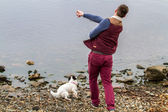 Man throwing a stone into a Loch — Stock Photo