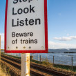 Stop beware of trains sign — Stock Photo #31117391