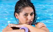 Beautiful girl in the pool — Stock Photo