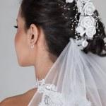 Beautiful young bride in wedding dress — Stock Photo #13254419