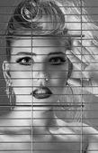 Fashion beautiful woman inside jail cell — Stock Photo