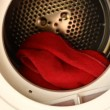 Hands loading laundry dryer — Stock Video #21412717