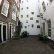 Stock Video: Begijnhof, one of oldest inner courts in city of Amsterdam, Holland