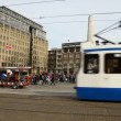 Stock Video: Tram in Dam square, amsterdam, Holland