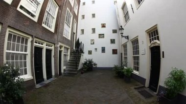 The Begijnhof, one of the oldest inner courts in the city of Amsterdam, Holland — Stock Video
