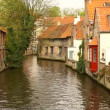 Canal and boats in the historic center of Bruges, Belgium - Stock Photo