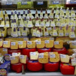 Choice of gourmet cheese offered in the market - Foto Stock