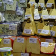 Choice of gourmet cheese offered in the market - Stock Photo