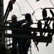 Electricians of the Israel Electric Co fixing high voltage electrical lines — Stock Video