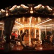 Santa on carousel - Stock Photo